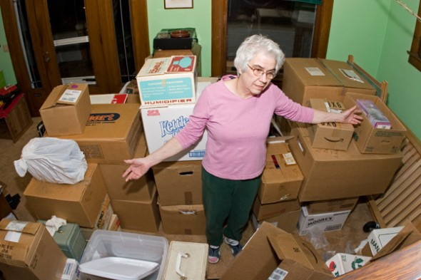 Mom, overwhelmed with stuff to get rid of.