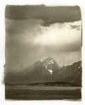 The tip of the Grand Teton is capped by a storm cloud passing through the park.