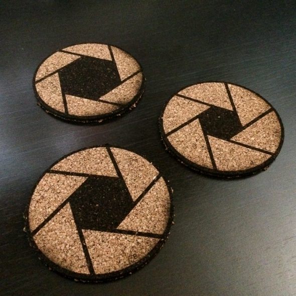 Aperture coasters. Yes, each one is different, ranging from f/2.8 to f/16. Functional AND educational!