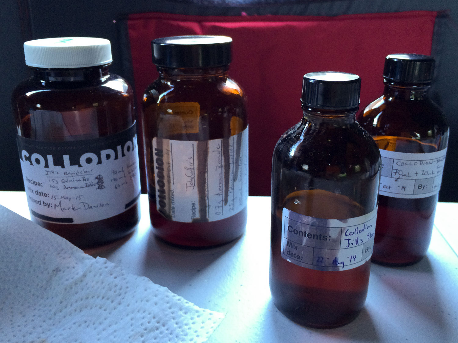 Since I was focusing on only one or two compositions, I took the opportunity to directly compare a few different batches of collodion - either different recipes, or different ages. These were the four I worked with today.