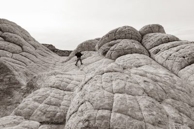 "Jonathan hops across the ""brain rock"" at White Pocket, Arizona."