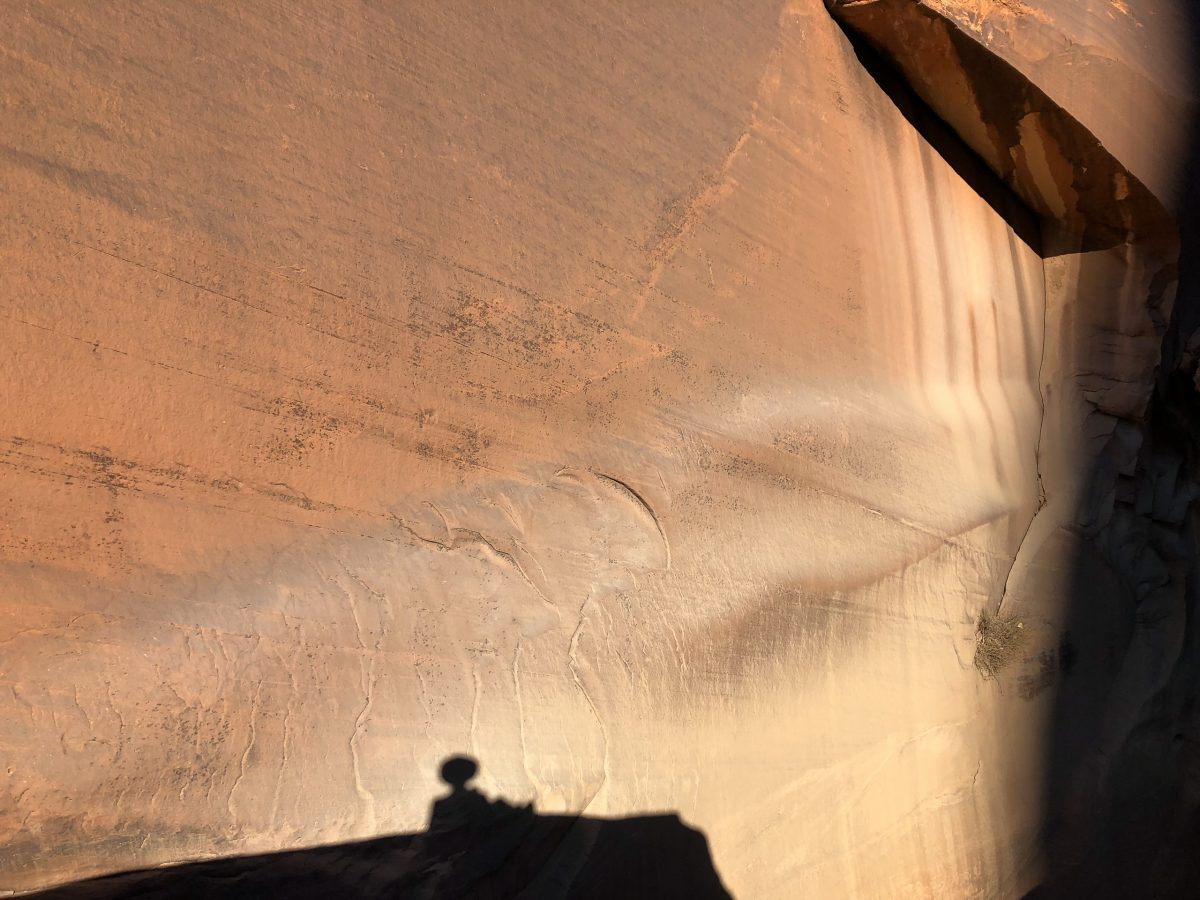 Mark's shadow waits for his hiking companions along the wall of Fifty Mile Canyon in Utah.