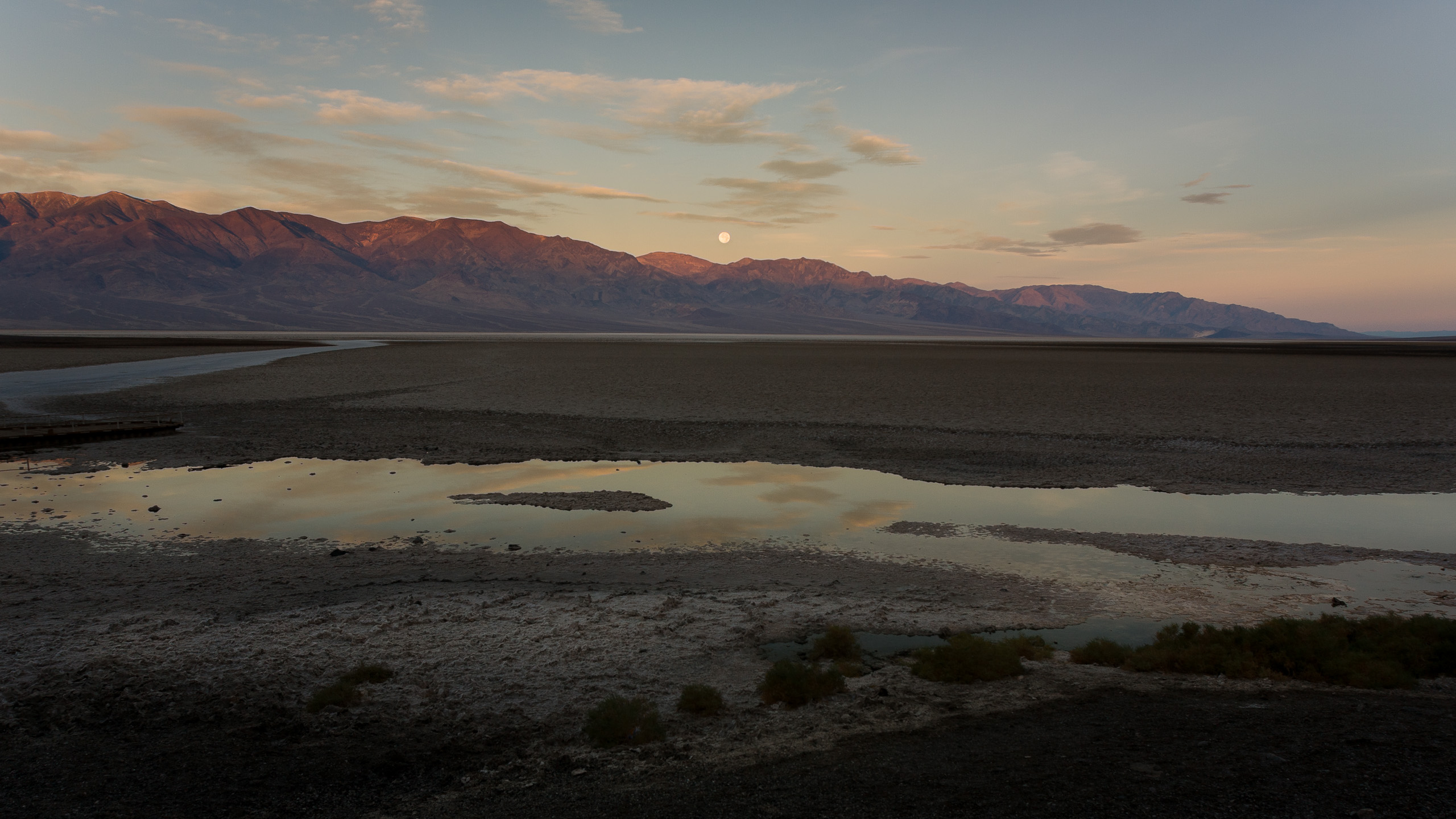 Sunrise and moonset over Badwater Basin, -282 ft elevation, Death Valley, California.