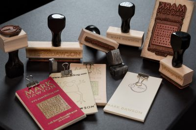 Custom designed rubber stamps and business cards